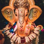gold and purple hindu deity figurine