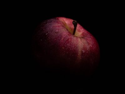 red apple with black background